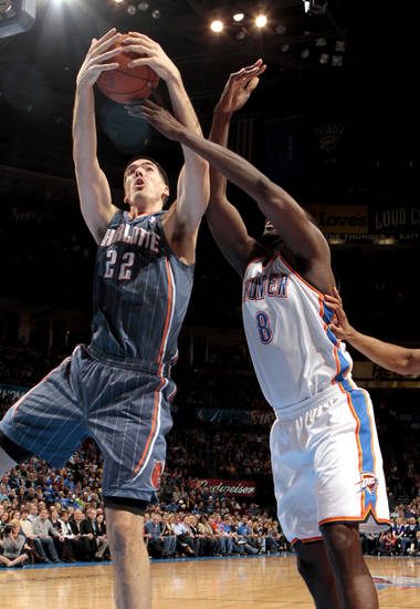 Charlotte Bobcats' Byron Mullens (22) fights Oklahoma City Thunder's Nazr Mohammed (8) for a rebound during the NBA basketball game between the Oklahoma City Thunder and the Charlotte Bobcats at Chesapeake Energy Arena in Oklahoma City, Saturday, March 10, 2012. Photo by Steve Sisney, The Oklahoman