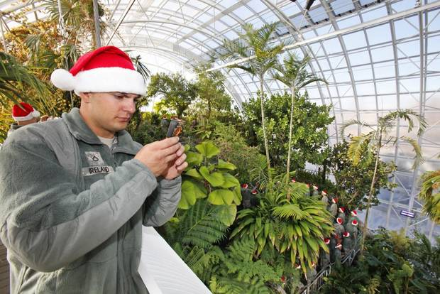 New recruit Travis Ireland takes a photo from the walkway in the Crystal Bridge at the Myriad Gardens during Soldiers Day Out, Friday, December 21, 2012. Edmond/North OKC Blue Star Mothers will be taking the soldiers who can't go home for Christmas around the metro for a day of fun. Photo By David McDaniel/The Oklahoman