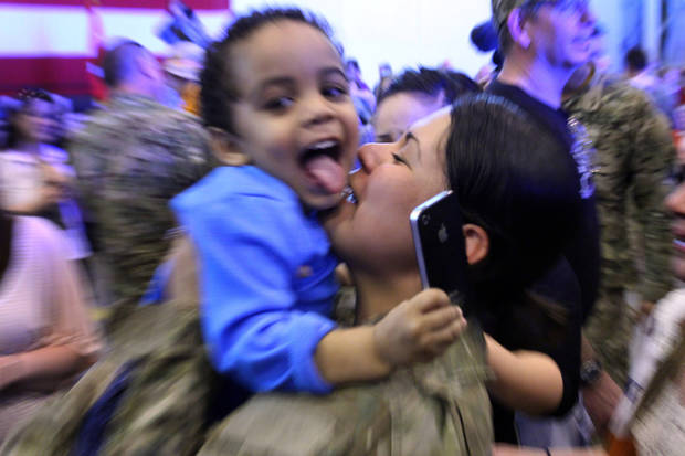 SPC Yuseli Freire kisses her son Yuni during the return ceremony for the National Guard's 45th Infantry Brigade Combat Team at the Army Aviation hanger at Will Rogers Air National Guard Base Sunday, March 25th, 2012. PHOTO BY HUGH SCOTT, FOR THE OKLAHOMAN