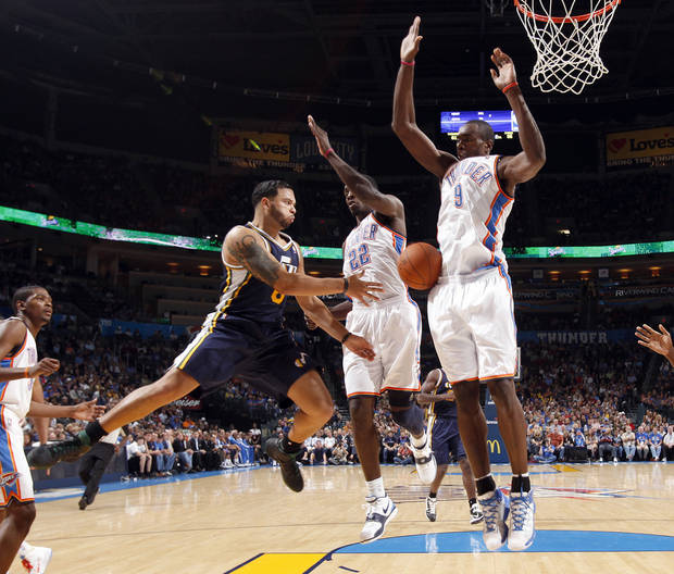 Oklahoma City's Jeff Green (22) and Serge Ibaka (9) defend against Utah's Deron Williams during the NBA basketball game between the Oklahoma CIty Thunder and Utah Jazz in the Oklahoma City Arena on Sunday, Oct. 31, 2010. Photo by Sarah Phipps, The Oklahoman