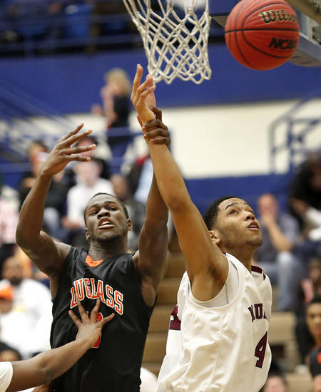 Douglass' Glenn Banks grabs the wrist of Muldrow's Gherrold Kimbrew as both players go for a rebound during first round games of Class 4A basketball state tournament in the Lyle Boren Activity Center at Choctaw High School on Thursday,  March 7, 2013.  Photo by Jim Beckel, The Oklahoman