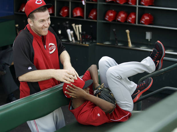 Darren Baker, son of Cincinnati Reds manager Dusty Baker, gets teased by Reds third baseman Todd Frazier before Game 1 of the National League division baseball series between the San Francisco Giants and the Reds in San Francisco, Saturday, Oct. 6, 2012. Ten years after Darren Baker nearly got run over at home plate when he wandered into the World Series action, he's still not old enough to be a bat boy. Darren Baker is just fine with it, because these days he's a second baseman who appreciates watching the games to learn. He does plan to bat boy for a few games in 2013 after turning the required 14 on Feb. 11. (AP Photo/Eric Risberg)