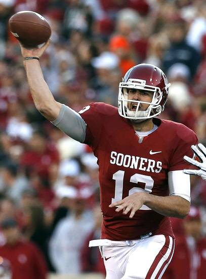 Oklahoma&#039;s Landry Jones (12) throws a pass during the Bedlam college football game between the University of Oklahoma Sooners (OU) and the Oklahoma State University Cowboys (OSU) at Gaylord Family-Oklahoma Memorial Stadium in Norman, Okla., Saturday, Nov. 24, 2012. OU won 51-48 in overtime. Photo by Sarah Phipps, The Oklahoman
