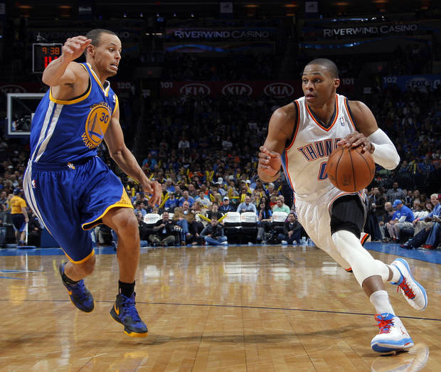 Oklahoma City 's Russell Westbrook (0) drives the ball past Golden State's Stephen Curry (30) during an NBA basketball game between the Oklahoma City Thunder and the Golden State Warriors at Chesapeake Energy Arena in Oklahoma City, Sunday, Nov. 18, 2012.  Photo by Garett Fisbeck, The Oklahoman
