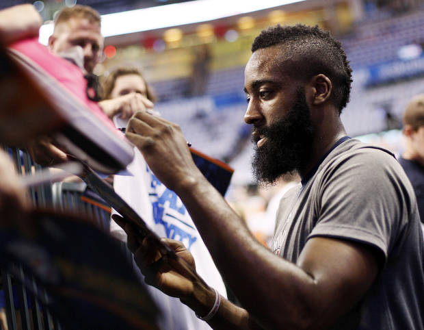 Oklahoma City's James Harden signs autographs before Game 2 of the first round in the NBA playoffs between the Oklahoma City Thunder and the Dallas Mavericks at Chesapeake Energy Arena in Oklahoma City, Monday, April 30, 2012. Photo by Nate Billings, The Oklahoman