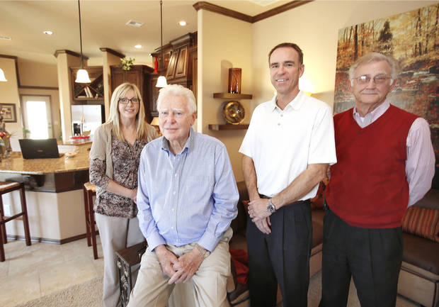 Angie Glover, J.W. Mashburn, Jesse Mashburn and Tony McGrew of J.W. Mashburn Homes show a model home at 3129 SW 136 Terrace.