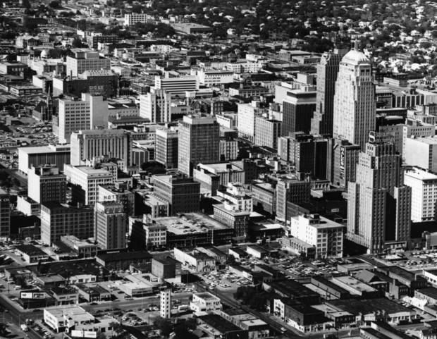 OKLAHOMA CITY / SKY LINE / OKLAHOMA / AERIAL VIEWS / AERIAL PHOTOGRAPHY / AIR VIEWS:  DOWNTOWN OKC (shows mummers Theater blocks).  Photo dated 04/25/1968 and unpublished.  Photo arrived in library 04/30/1968.