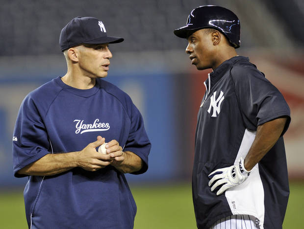 New York Yankees manager Joe Girardi, left, talks with Curtis Granderson during baseball practice Friday, Oct. 5, 2012, at Yankee Stadium in New York for an American League division series. (AP Photo/Bill Kostroun)