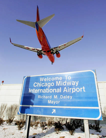 In this file photo, a Southwest Airlines come in for a landing at Midway International Aiport in Chicago. Southwest Airlines Co., which has bashed competitors for charging fees, said Friday it will add new fees for passengers who bring small pets onboard and for unaccompanied minors. Ap photo