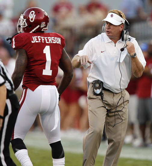 Mike Stoops talks with Oklahoma's Tony Jefferson (1) during the college football game between the University of Oklahoma Sooners (OU) and the Kansas State University Wildcats (KSU) at the Gaylord Family-Memorial Stadium on Saturday, Sept. 22, 2012, in Norman, Okla. Photo by Chris Landsberger, The Oklahoman