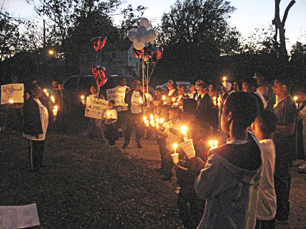 Friends and family of Robin Leander Howard meet in the 1400 block of Monticello Court for a candelight vigil honoring his life Sunday night. Howard, 54, died four days after his arrest in June. <strong>MATT DINGER</strong>