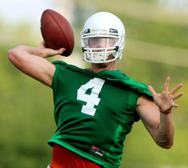 Quarterback Brandon Weedon throws a pass during the first Oklahoma State University fall football practice, in Stillwater, Okla., Thursday, July 31, 2008. BY MATT STRASEN, THE OKLAHOMAN