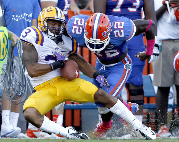 Florida safety Matt Elam, right, forces LSU wide receiver Odell Beckham Jr. to fumble the ball after a long reception during the third quarter of an NCAA college football game at Ben Hill Griffin Stadium on Saturday, Oct. 6, 2012 in Gainesville, Fla. Florida recovered the fumble and defeated LSU 14-6. (AP Photo/Matt Stamey, The Gainesville Sun) MAGS OUT, INDEPENDENT ALLIGATOR OUT