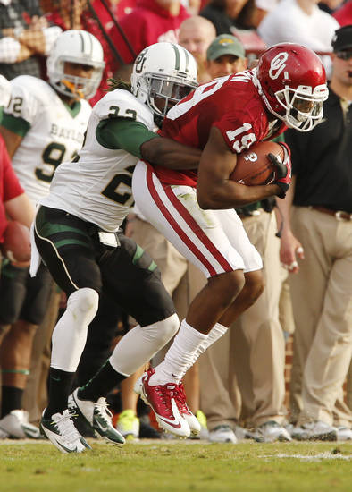 Oklahoma Sooner Justin Brown (19) catches a pass and is stopped by Joe Williams (22) during the college football game between the University of Oklahoma Sooners (OU) and the Baylor University Bears (BU) at Gaylord Family-Oklahoma Memorial Stadium in Norman, Okla., Saturday, Nov. 10, 2012.  Photo by Steve Sisney, The Oklahoman