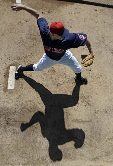 Cleveland Indians starting pitcher Justin Masterson warms up in the bullpen before an exhibition spring training baseball game against the Chicago White Sox, Friday, March 1, 2013, in Goodyear, Ariz. (AP Photo/Mark Duncan)