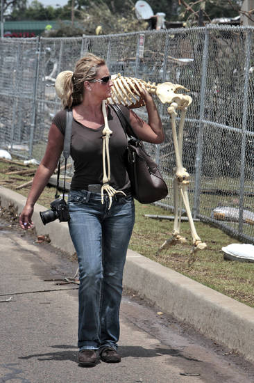 Kristin Earley, a Doctor of Osteopathic Medicine and her friend Christy Goodger return with Lucy a skeleton that Earley uses in her practice that was lost in the May 20th tornado at the Moore Medical Center, Thursday, May 23, 2013.  Photo by David McDaniel, The Oklahoman