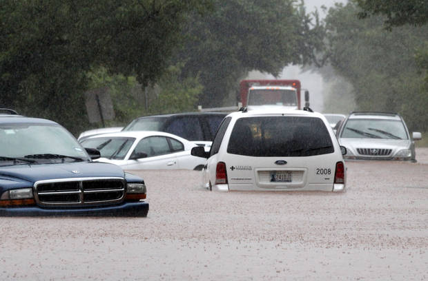 Cars are almost covered in water on Hefner Road just east of the Broadway Extension in Oklahoma City, OK, Monday, June 14, 2010. By Paul Hellstern, The Oklahoman