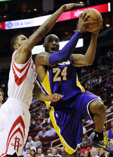 Los Angeles Lakers' Kobe Bryant (24) goes to the basket against Houston Rockets' Marcus Morris in the first half of an NBA basketball game, Tuesday, Dec. 4, 2012, in Houston. (AP Photo/Pat Sullivan)
