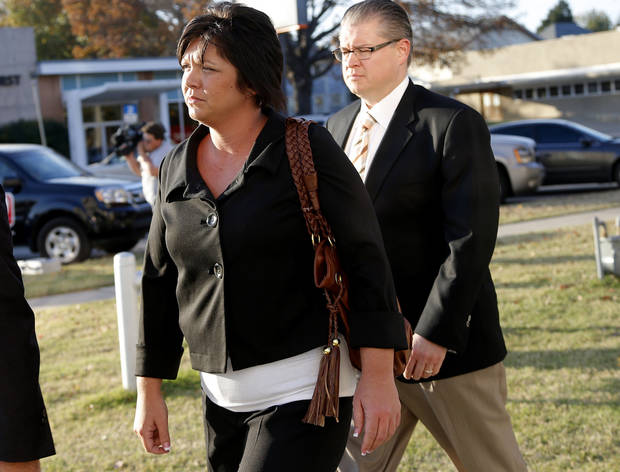 Fired DHS child welfare supervisor Jennifer Shawn walks to the Pottawatomie County Courthouse Friday to plead no contest to a misdemeanor charge.