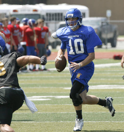 New Stillwater coach Tracy Barnard has senior quarterback Jerame Littell, right, on his team in 2011. PHOTO BY PAUL HELLSTERN, THE OKLAHOMAN