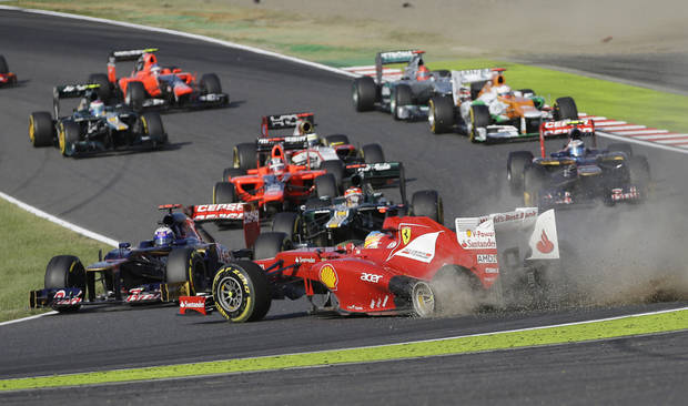 Ferrari driver Fernando Alonso of Spain spins off the track at the start of the Japanese Formula One Grand Prix at the Suzuka Circuit in Suzuka, Japan, Sunday, Oct. 7, 2012. (AP Photo/Mark Baker)