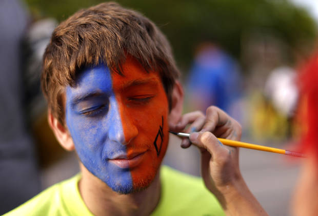 Blake Rhoades, of Ponca City, Okla., gets his face painted before Game 5  in the first round of the NBA playoffs between the Oklahoma City Thunder and the Houston Rockets at Chesapeake Energy Arena in Oklahoma City, Wednesday, May 1, 2013. Photo by Sarah Phipps, The Oklahoman