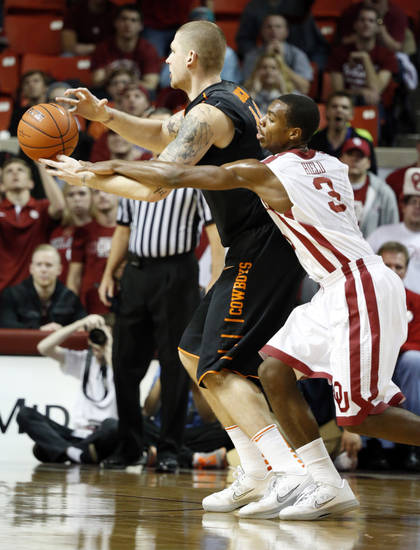Sooner's Buddy Hield (3) tries to defend Cowboy's Philip Jurick (44) during the second half as the University of Oklahoma Sooners (OU) defeat  the Oklahoma State Cowboys (OSU) 77-68  in NCAA, men's college basketball at The Lloyd Noble Center on Saturday, Jan. 12, 2013  in Norman, Okla. Photo by Steve Sisney, The Oklahoman