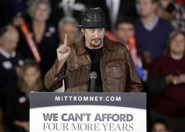 Recording artist Kid Rock speaks before introducing Republican vice presidential candidate, Rep. Paul Ryan, R-Wis., at a rally at Oakland University in Rochester, Mich., Monday, Oct. 8, 2012. (AP Photo/Paul Sancya)
