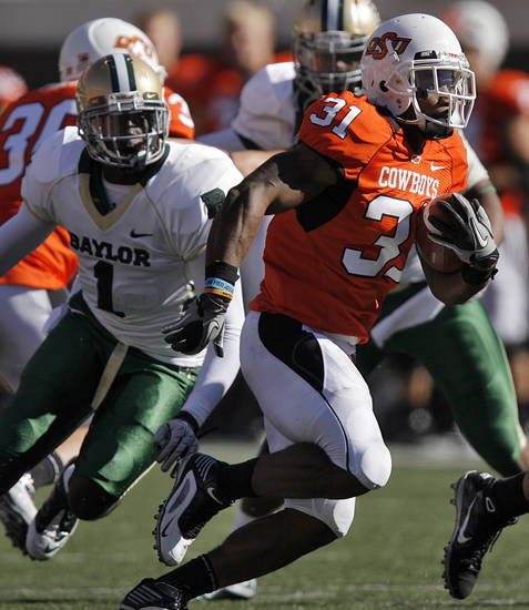 Oklahoma State's Jeremy Smith (31) runs past Baylor's Prince Kent (1) during the college football game between the Oklahoma State University Cowboys (OSU) and the Baylor University Bears at Boone Pickens Stadium in Stillwater, Okla., Saturday, Nov. 6, 2010. Photo by Chris Landsberger, The Oklahoman