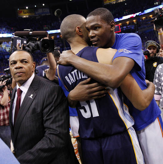 OKLAHOMA CITY ARENA / PLAYOFFS: Oklahoma City's Kevin Durant (35) hugs Shane Battier (31) of Memphis next to Memphis head coach Lionel Hollins, left, after game 7 of the NBA basketball Western Conference semifinals between the Memphis Grizzlies and the Oklahoma City Thunder at the OKC Arena in Oklahoma City, Sunday, May 15, 2011. The Thunder won, 105-90. Photo by Nate Billings, The Oklahoman ORG XMIT: KOD