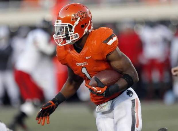 Oklahoma State's Joseph Randle (1) rushes during a college football game between Oklahoma State University and the Texas Tech University (TTU) at Boone Pickens Stadium in Stillwater, Okla., Saturday, Nov. 17, 2012. Photo by Sarah Phipps