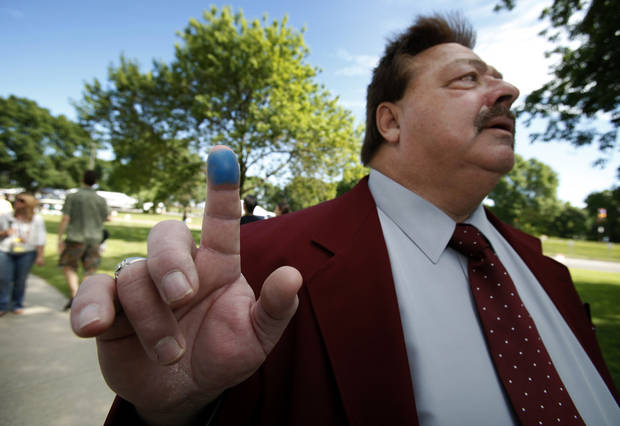 Rodney Skinner, of Ottumwa, Iowa, shows his marked finger that indicates he voted after casting his ballot in the Republican Party's Iowa Straw Poll, Saturday, Aug. 13, 2011, in Ames, Iowa. (AP Photo/Charlie Neibergall)