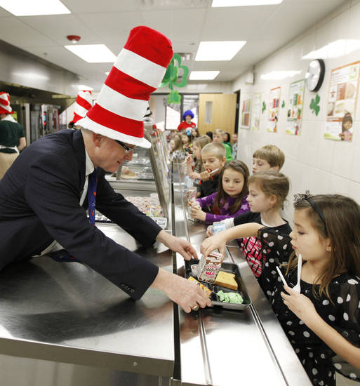 Edmond Public Schools Superintendent David Goin serves green eggs and ham to first-graders at Clegern Elementary School in honor of Dr. Seuss' birthday. PHOTO BY PAUL HELLSTERN, THE OKLAHOMAN. <strong>PAUL HELLSTERN - PAUL HELLSTERN</strong>
