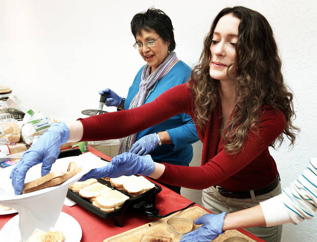 Nancy Smith, left, and Kimberly Minor make sandwiches for &acirc;Art From the Heart&acirc; attendees.