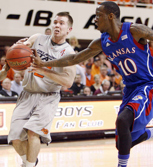 KU's Tyshawn Taylor (10) knocks the ball away from OSU's Keiton Page (12) in the first half during a men's college basketball game between the Oklahoma State University Cowboys and the University of Kansas Jayhawks at Gallagher-Iba Arena in Stillwater, Okla., Monday, Feb. 27, 2012. Photo by Nate Billings, The Oklahoman