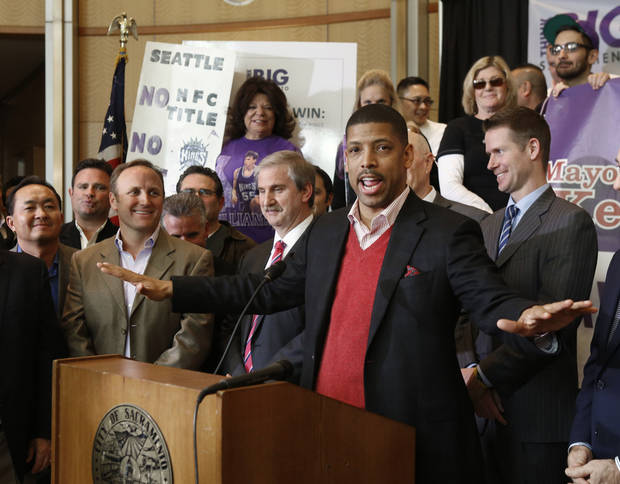 Sacramento Mayor Kevin Johnson speaks during a news conference to introduce the first part of his four-step plan to keep the Sacramento Kings NBA basketball team in Sacramento, Calif., on Tuesday, Jan. 22, 2013. Johnson, who said he has 19 local investors who have pledged at least $1 million each to buy the franchise, made his announcement a day after the Maloof family announced it has signed an agreement to sell the Kings to a Seattle group led by investor Chris Hansen. (AP Photo/Rich Pedroncelli)