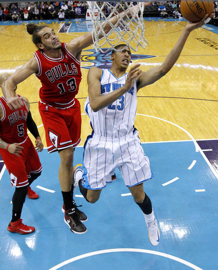 New Orleans Hornets forward Anthony Davis (23) goes to the basket against Chicago Bulls center Joakim Noah (13) during the second half of an NBA basketball game in New Orleans, Tuesday, Feb. 19, 2013. The Bulls won 96-87. (AP Photo/Jonathan Bachman)