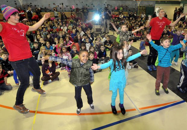 In this Feb. 4, 2013 photo, students from Ravenwood Elementary join members of the Alaska Pacific University ski team (in red) in a dance during an assembly to celebrate the school's win in the State of Alaska's Healthy Futures Challenge in Eagle River, Alaska. The statewide program is designed to encourage schoolchildren to exercise or play every day. (Photo by Matt Tunseth/Chugiak-Eagle River Star)
