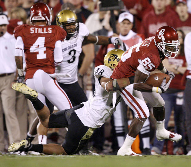OU's Ryan Broyles fights off Colorado's Liloa Nobriga during the college football game between the University of Oklahoma (OU) Sooners and the University of Colorado Buffaloes at Gaylord Family-Oklahoma Memorial Stadium in Norman, Okla., Saturday, October 30, 2010. Photo by Bryan Terry, The Oklahoman