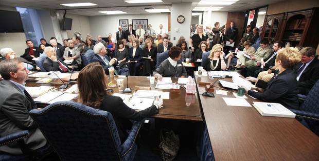 A standing-room-only crowd fills the room Thursday during a state Board of Education meeting in Oklahoma City. The state Education  Department is releasing A-F grades for schools throughout the state.  Photo By Paul Hellstern. The Oklahoman