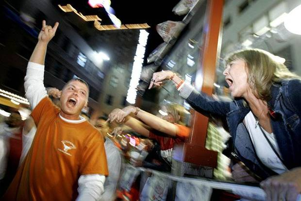 Jan Gillespie from Norman, Okla, yells at Texas fan Sam Hilpirt, from Denton, Texas, in the West End District of Dallas, October 7, 2005. BY BRYAN TERRY, THE OKLAHOMAN