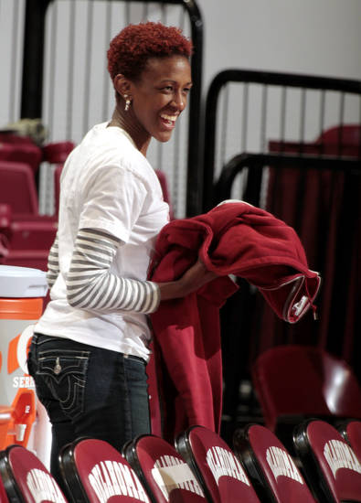 Former Sooner player Danielle Robinson attends the game as the University of Oklahoma Sooners (OU) play the West Virginia Mountaineers in NCAA, women's college basketball at The Lloyd Noble Center on Wednesday, Jan. 2, 2013  in Norman, Okla. Photo by Steve Sisney, The Oklahoman