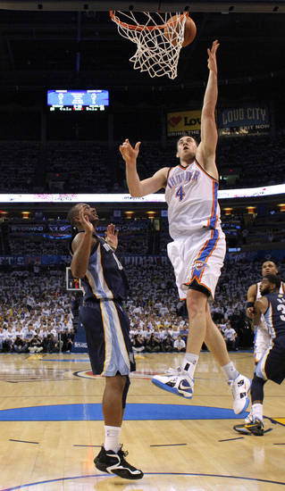 Oklahoma City&#039;s Nick Collison (4) goes to the basket beside Darrell Arthur (00) of Memphis during game five of the Western Conference semifinals between the Memphis Grizzlies and the Oklahoma City Thunder in the NBA basketball playoffs at Oklahoma City Arena in Oklahoma City, Wednesday, May 11, 2011. Photo by Bryan Terry, The Oklahoman