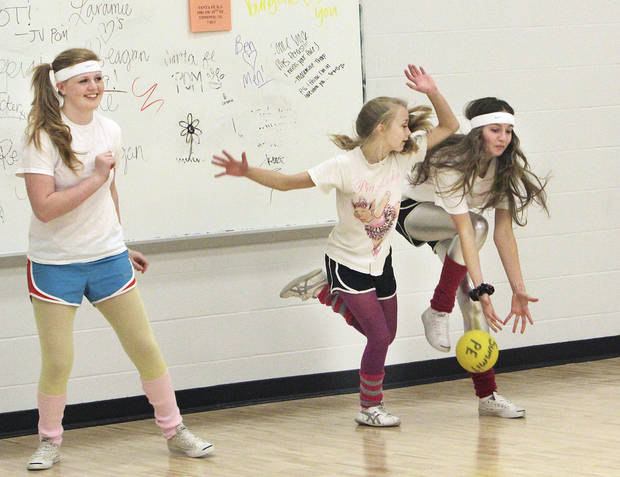 Sophomores Lauren Portwood, Joelle Glimp and Kelsey Almond try to avoid being hit during  Edmond Santa Fe High School's Duckball  tournament as part of Double  Wolf Dare Week, Wednesday, February 29, 2012.     Photo by David McDaniel, The Oklahoman