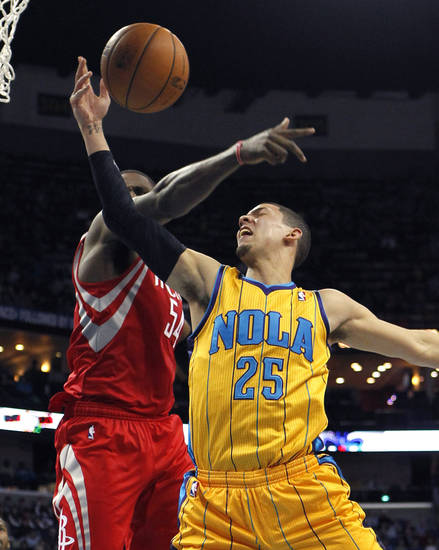 New Orleans Hornets  guard Austin Rivers (25) drives to the basket against Houston Rockets forward Patrick Patterson (54) in the second half of an NBA basketball game in New Orleans, Friday, Jan. 25, 2013.  The Rockets won 100-82. (AP Photo/Gerald Herbert)