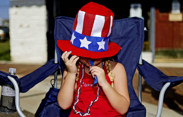 Hannah Hargis, 6, of Edmond enjoys a snack as she watches the LibertyFest Fourth of July Parade in Edmond, Okla., Wednesday, July 4, 2012. Photo by Bryan Terry, The Oklahoman