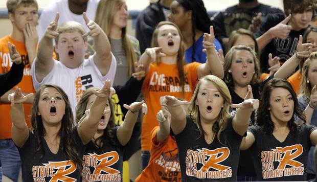 Roland fans cheer on their team during the state high school basketball tournament Class 4A boys semifinal game between McLain High School and Roland High School at the State Fair Arena on Friday, March 8, 2013, in Oklahoma City, Okla. Photo by Chris Landsberger, The Oklahoman