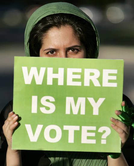 Mahsa holds a sign protesting the recent election in Iran at the American Muslim Association in Oklahoma City, June 18, 2009.  Photo by Steve Gooch, The Oklahoman