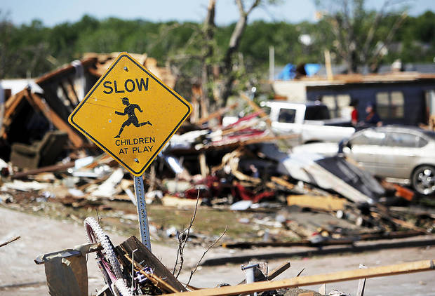 TORNADO DAMAGE / AFTERMATH / CLEAN UP / CLEANUP: A sign stands among piled debris in Woodward, Okla., Monday, April 16, 2012.  A tornado struck the town early Sunday morning. Photo by Nate Billings, The Oklahoman