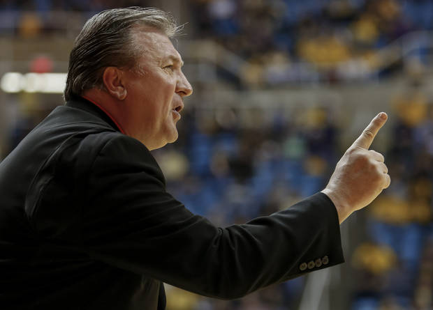 West Virginia head coach Bob Huggins yells to a Mountaineer player during the first half of an NCAA college basketball game against Radford at WVU Coliseum in Morgantown, W.Va., on Saturday, Dec. 22, 2012. (AP Photo/David Smith)